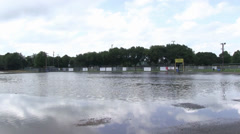 Pan across flooded parking lot Stock Footage