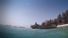 Thai boats at Khao Lak beach - Thailand Stock Footage