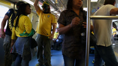 Foreign talks to Brazilians in subway before Brazil x Croatia in 2014 World Cup Stock Footage