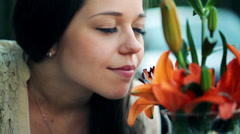 Happy young woman smelling beautiful colorful flowers HD Stock Footage