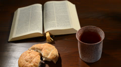 Stock Video Footage of bible with chalice and bread, panning,sliding