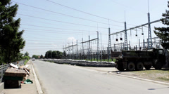 Defense transmission line with sandbags from floods,car passes,wide angle. Stock Footage
