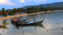 Fishing boats bobbing in the sea at sunset, fishermen preparing to sail. Video Stock Footage