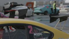 Huge spoiler of yellow racing car on the parking Stock Footage