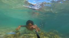 Underwater camera, Sea Bajau swimming Stock Footage