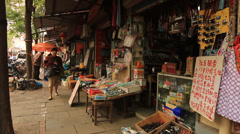 Street life at Shanghai Former French Concession with shops Stock Footage