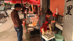 Street life Shanghai Former French Concession with shop life Stock Footage