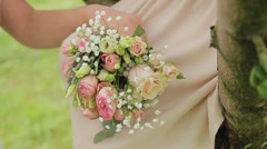 Flowers on the girls' knees Stock Footage