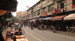 Stock Video Footage of Street life traffic and shops Shanghai Former French Concession