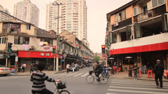 Street life traffic at a crossing Shanghai Former French Concession Stock Footage