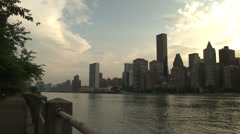 Sunset over Manhattan, seen across the East River - stock footage