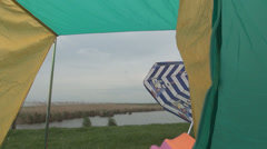 View from the tent at pond, Cloudy day, Holiday in tent, Camping with tent Stock Footage