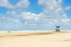 drowning house at the beach - stock photo