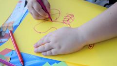 Child drawing on paper Stock Footage