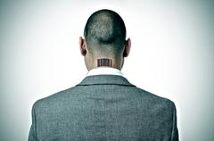 businessman with a barcode in his nape - stock photo