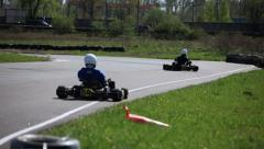 Race Go-kart in a curve rear view Stock Footage