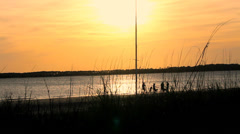 family silhouette sunset beach sailboat mast - stock footage