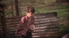 Vintage 1970's, 8mm boy feeding chickens Stock Footage