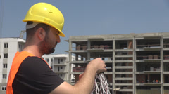 Construction cable worker helmet on checking coil of wires jack ready to install Stock Footage