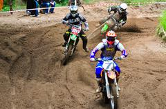 Motocross riders on the championship race Stock Photos