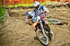 Motocross rider on the championship race Stock Photos
