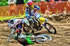 Motocross riders on the championship race Stock Photos