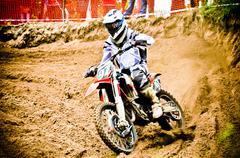 motocross rider on the championship race - stock photo