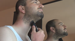 Morning dry shaving for a student man using wireless trimmer nice mirror view Stock Footage