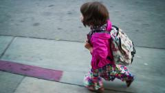 Cute little girl in colorful clothes walking to school with backpack Stock Footage