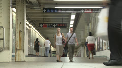 Time lapse anonymous crowd moving between subway platforms Stock Footage