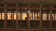 Subway train runs trough empty station -side view Stock Footage