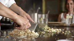 Hibachi chef mixes the fried rich HD Stock Footage