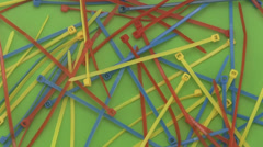Cable ties or ny-lock on a green background. Stock Footage