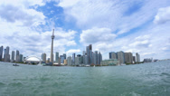 Stock Video Footage of 4K Toronto Skyline from Lake Ontario with CN Tower