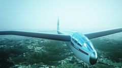 Sailplane over snow capped mountains. - stock footage