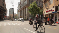 Shanghai Street Life Bicycles and car traffic near Nanjing Road Stock Footage
