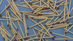 Match sticks on a blue background. Stock Footage