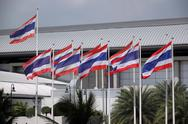 Stock Photo of flag of thailand hit by strong wind.