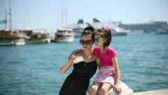 Mother and daughter on vacation photographed beside the Adriatic Sea in Croatia Stock Footage