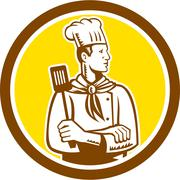 Chef cook holding spatula side view circle Stock Illustration