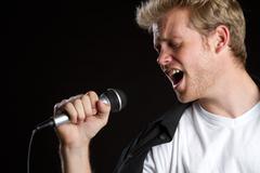 karaoke singer man - stock photo