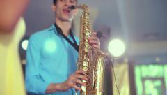 Dark-skinned black woman singer and thin saxophone player performing on stage. Stock Footage