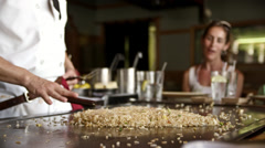 Hibachi chef organizes the fried rice 4K Stock Footage