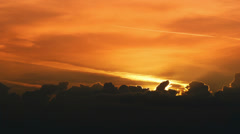 Morning sunrise through the clouds - stock footage