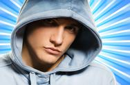 Stock Illustration of handsome young man in a hood over abstract blue background