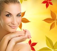 Beautiful young woman over abstract autumn background Piirros