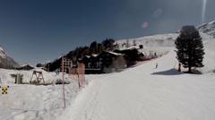 Relaxed skiers skiing at Matterhorn area Riffelalp Stock Footage