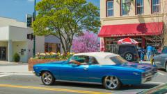 Classic Car Driving Past Cafe on Main Street Hendersonville, NC Stock Footage