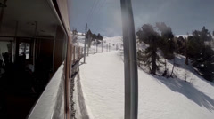 Outside window view traveling with train in snowy alpine area Stock Footage