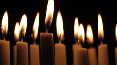 Dimly Lit Burning Candles Create Mood Stock Footage